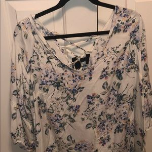 Cream colored blouse with flowers.